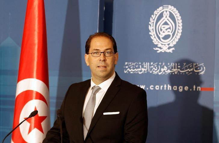 Tunisia's PM-designate Youssef Chahed speaks during a news conference after his meeting with Tunisia's President Beji Caid Essebsi in Tunis