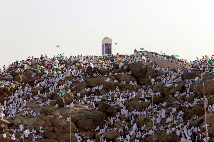 Muslim pilgrims gather on Mount Mercy on the plains of Arafat during the annual haj pilgrimage, outside the holy city of Mecca