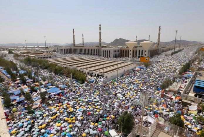 Muslim pilgrims leave after they finished their prayers at Namira Mosque in Arafat