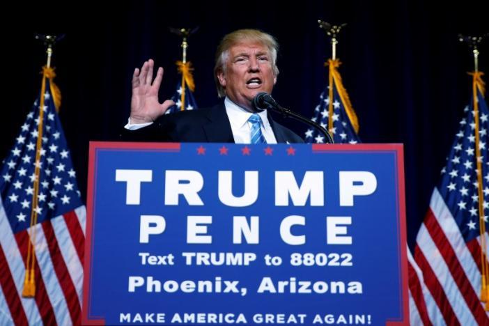 Republican presidential nominee Donald Trump speaks at a campaign rally in Phoenix, Arizona, U.S., August 31, 2016.   REUTERS/Carlo Allegri