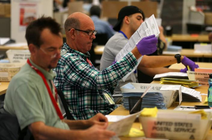 Election workers verify mail-in ballots at the San Diego County Elections Office in San Diego, California, U.S., November 7, 2016. REUTERS/Mike Blake
