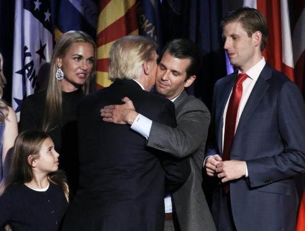 U.S. President-elect Donald Trump embraces his son Donald Trump Jr. during his election night rally in Manhattan, New York, U.S., November 9, 2016. REUTERS/Mike Segar