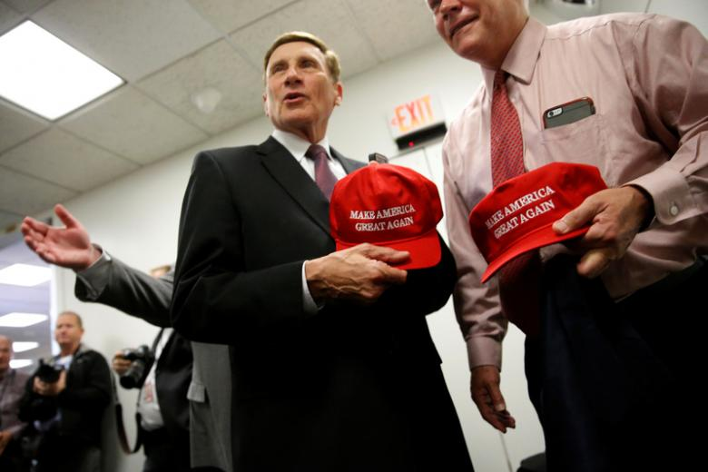 "U.S. Representative John Mica (R-FL) (C) and Representative Pete Sessions (R-TX) (R) speak with reporters as they depart with Trump campaign ""Make America Great Again"" hats distributed at a House Republican caucus meeting at the U.S. Capitol in Washington, U.S. November 15, 2016. REUTERS/Jonathan Ernst"