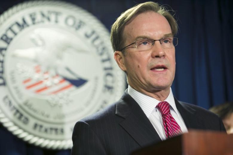 "Michigan Attorney General William ""Bill"" Schuette speaks in Boston, Massachusetts, December 17, 2014. REUTERS/Dominick Reuter/File Photo"