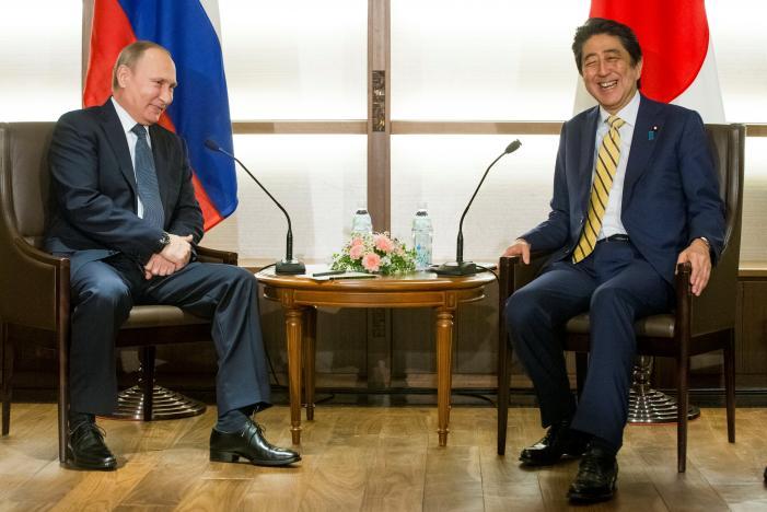 Japanese Prime Minister Shinzo Abe and Russian President Vladimir Putin smile during their meeting at a hot springs resort in Nagato, Japan, December 15, 2016. REUTERS/Alexander Zemlianichenko/Pool